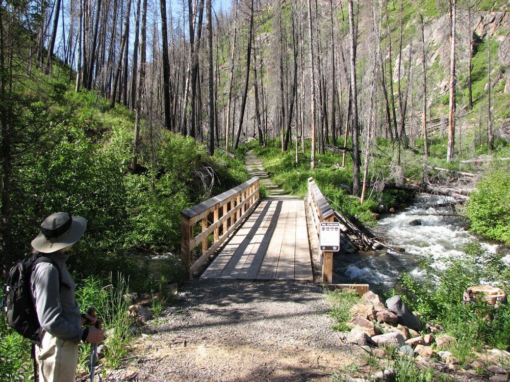 Photo of bridge across Mill Creek as it is being joined by Passage Creek