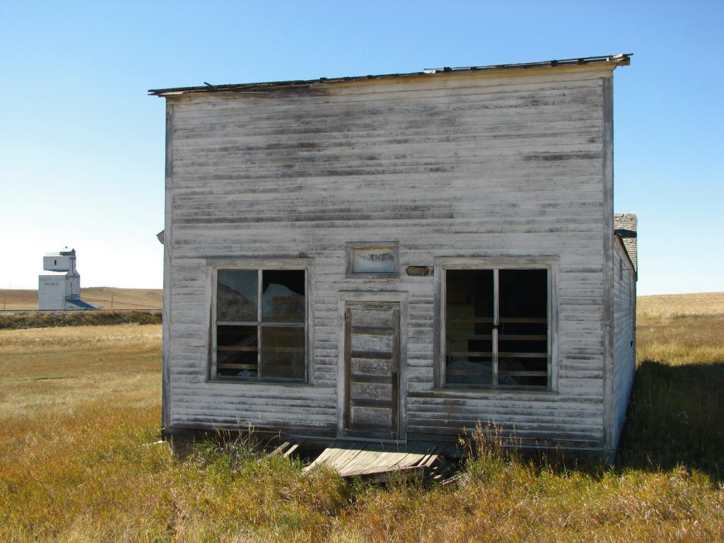 Photo of abandonded building sitting along an abandonded railroad in Central Montana